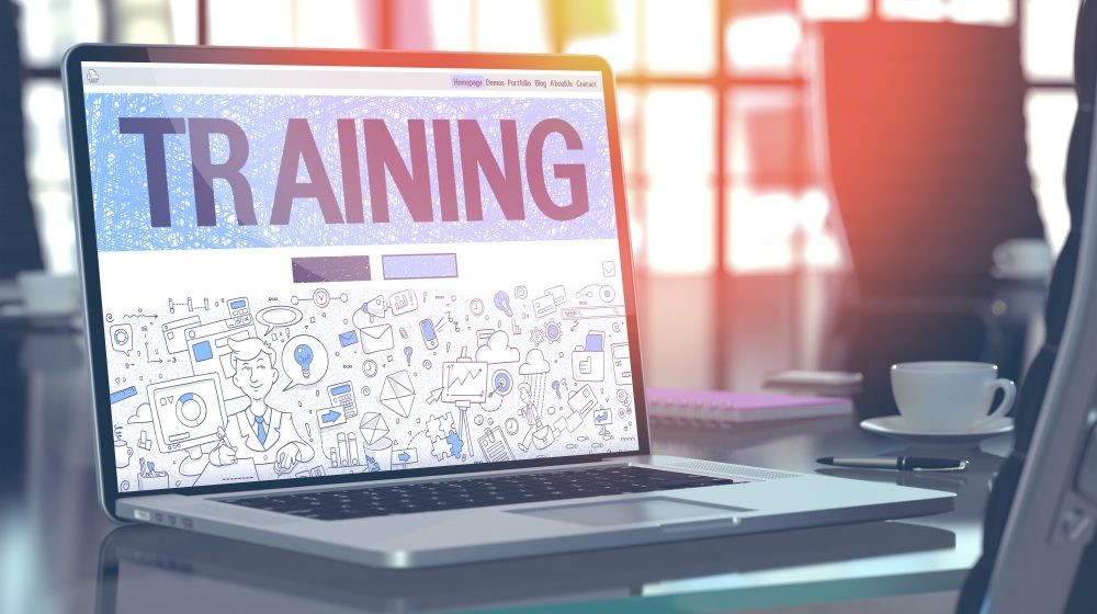 laptop which reads training across the screen