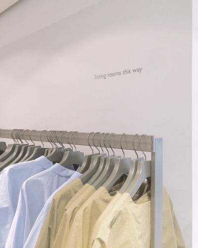 a tshirt rack containing blue and yellow tshirts